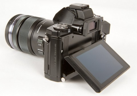 Olympus E-M5 has a tiltable OLED monitor